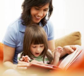 Photo of parent reading with child.